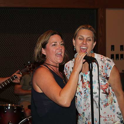 Open-mic event with two guests singing.