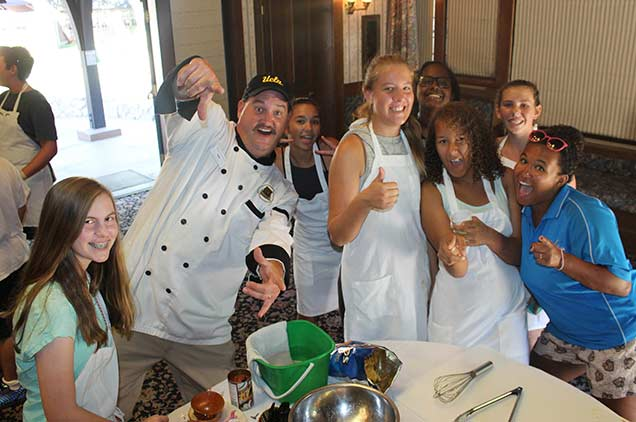 A group of diners posing with the chef.