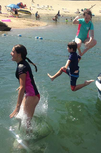 Children playing in the water on the shor of Lake Arrowhead
